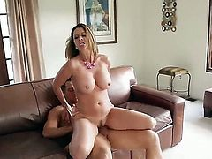 This handsome sporty stud Johnny Castle is seduced to have wild sex by Raquel Devine. Gorgeous milf is exposing her delights before getting licked and fucked in mouth and twat.