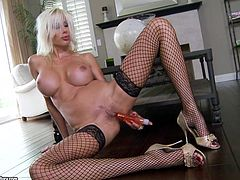 Sexy blonde milf Puma Swede takes her thong off and rubs it against her pussy. Then she takes a dildo and fucks her pink slit with it.