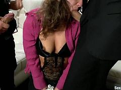 Beautiful girl with hairy pussy gets undressed and tied up. After that she sucks dicks and gets double penetrated.