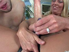 Brenda James is a sexy blond-haired MILF with strapon dildo. Blonde in high heels gets her feet licked by the pool and then guy gives head to hot domina indoors. Watch blonde with fake cock have fun!