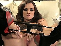 Amazing skinny babe Tori Black is showing her fit body on camera while masturbating on the couch, wearing her sexy boots and using her awesome dildo toy.