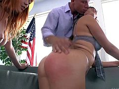 Marie McCray and Holly Michaels are lovely girls with wet big round asses. Brunette in stockings and mini skirt gets her butt spanked by redhead and gives blowjob to hot guy at the same time.