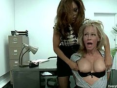 Two chicks take their clothes off in an office and then toy each others asses. After that both girls get ass fucked.