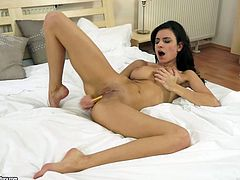 Charming brunette Gabi de Castello strokes her nice body and gets horny. Then she fingers her pussy and fucks it with a dildo.