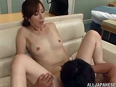 Slutty Japanese milf favours her neighbour with a hot blowjob. After that she lies down on the bed and allows the dude to fuck her throbbing vag in missionary position.