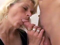 Have a look at this hardcore scene where a kinky mature blonde sucks on a guy's big cock before he pounds her hairy pussy.