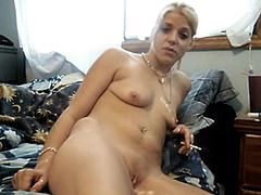 She loves masturbating her tight pussy with her toy and feel it making her moan hard