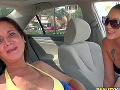 Brunette nest door in sexy bikini is busty and cash hungry. She pulls out her huge round tits for money. This beach girl demonstrates her lovely fake boobs in a car playfully.