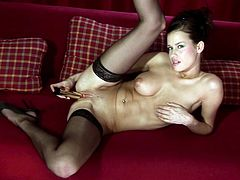 Gorgeous brunette in stockings is giving a hot masturbation show