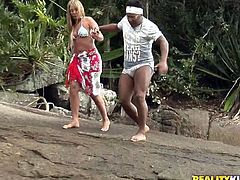 Rapacious black daddy is having a steamy date outdoors with a flamboyant white milf. They stop by the waterfalls where she stands in doggy style to rub her cunt with fingers in steamy interracial sex video by Reaity Kings.