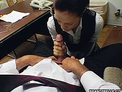 Here she is with her boss on her knees and going to town on his magic wand sucking until he cums on her.