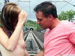 Two insatiable folks fuck right in the middle of railroad. Aroused daddy welcomes an oral fuck from spoiled red-haired teen in steamy fishnet stockings before she hangs down to continue ora fucking upside down. Later they continue fucking in sideways pose.