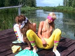 Slutty lesbians are having intense pleasure stimulating their warm clits in outdoor softcore