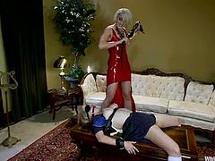 Two sexy blonde girls make an amazing femdom show in a bedroom. Penny gets hog tied and clothespinned. Later on she gets her vagina toyed with a vibrator and a strap-on.