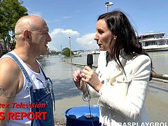 British news reporter Lara Latex seduces a bald headed man for a blowjob