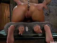Well-endowed Trina Michaels is having fin with Mark Davis and his friend in a hot BDSM scene. The men bind the bitch and poke their cocks into her pussy and mouth.