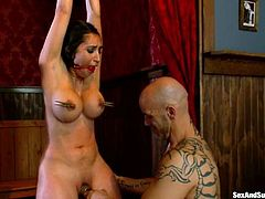 Brunette bombshell Alexis Breeze lets horny Derrick Pierce tie her up and attach clothes pegs to her nipples. Then she takes his prick in her vag and enjoys the way it moves back and forth in her depths.