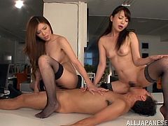 Two adorable Japanese girls in fishnets and lingerie have some fun with their lucky colleague. They suck his dick and sit on his face. They also ride his cock passionately.