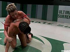 Mahina Zaltana, Sara Jay and one more nude girl are having a struggle on tatami. They beat each other and then drill one another's holes with a strapon.