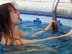 Two skinny and innocent-looking girlfriends Ivana and Vika have sweet time in the swimming pool playing and dabbling with their gentle tiny pussies!
