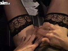 Slutty chick Marga wearing black stockings and a blindfold is having fun with some horny dude. She plays with his cock and takes it deep in her mouth.