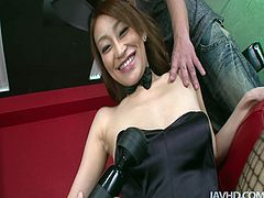 Yuu Kusunoki looks fricking hot in her fishnet pantyhose and black corset. She gives her man great blowjob and gets her cunt fondled with huge vibrator.