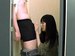 Nasty Japanese girl is having fun with a stranger in a bathroom. She kneels in front of him and begins to suck his dick ardently.