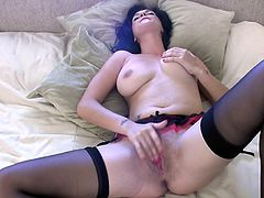 get a load of this passionate solo clip where a smoking hot brunette plays with her shaves pussy while squeezing her big tits.