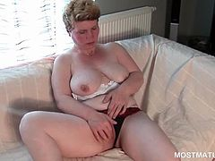 Shorthaired excited mature working her sexy big boobies and pussy