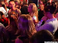 Join this crazy party which is full of slutty hoes. Sexy girls are dancing on a dance floor having fun. One of the girls kneels down taking massive dick in her mouth right on dance floor.