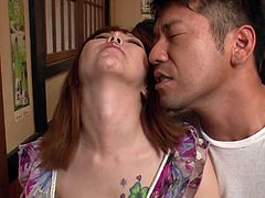Insatiable Japanese milf hooks up with two perverse fuckers. They maul her round big tits from both sides before they get to her shaved cunt, which they tease with different sex toys.