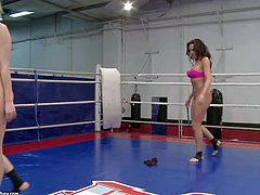 Young blonde and brunette babes Blue Angel and Rio Lee with delicious asses and nice juicy hooters gets naked during arousing chick fight and wrestle on the floor in ring