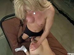 THis mature shemale Joanna Jet seduces Katie St. Ives and ties her hands up. Then she sticks her dick in her mouth before she pokes her hot pussy!