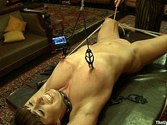 Get a load of this bondage scene where this hottie has her nipple tutored by her master while being tied up to a chair and at the same time being masturbated with a vibrator.