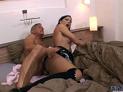 This grey haired guy has called for some room service and when a stunning maid arrives he bonks her.