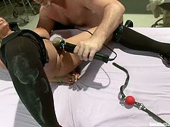 Ravishing blonde nurse Holly Halston is having fun with Mark Davis in a hospital ward. She lets the man tie her up and enjoys his hard dick in her mouth and cooch.