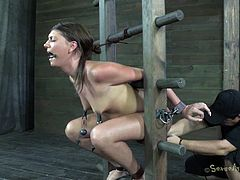 That position fits her the best. It takes out in advantage what's really important about her, her mouth and ass. She's a cheap whore and her only purpose is to make men cum. Watch this chick all tied up and immobilized on a wooden frame. She's being mouth fucked now but her ass won't be left unpunished!