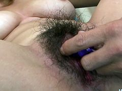 Well stacked dark haired Asian beauty named Rika Aina spreadsher sexy legs wide open exposing her super hairy cunt. Two guys finger her pink cooch and poke it with big vibrator.