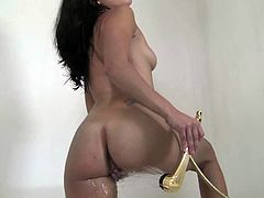 Feeling her warm clit getting wet during her solo makes brunette really horny and wild