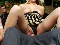 Hot tempered blond whore in sultry dress and stockings rides an aroused dude in reverse cowgirl style while other dudes jerk off watching them fucking in sultry gangbang sex video by Tainster.
