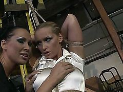 Handsome young brunette babe Kathia Nobili is being ass spanked by Mandy Bright, she tied her up and rudely scoffing on her
