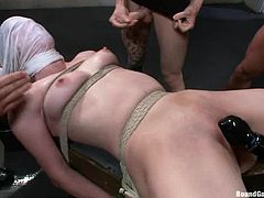 Sexy tied up and gagged girl gets gangbanged. She sucks dicks first and then gets double penetrated. Later on she also gets facialed.