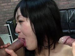 Filthy Japanese slut gets both her stretched pussy and gaped asshole double fucked with dildos before she kneels down to oral fuck two hard cocks at a time in peppering threesome sex video by Jav HD.