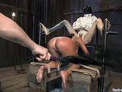 Tied up and gagged brunette girl sucks a cock with great pleasure. After that she gets fucked hard cowgirl by a guy in mask.