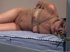 Naked young brunette Korina with pretty small natural perky tits and clean pussy gets tied to bed by kinky nurse Nikky Thorne. She gets foot fucked and smothered by dirty blonde girl at the hospital.