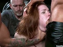 Stunning redhead girl takes her clothes off right in the bar. After that she starts to suck cocks putting them deep in her throat. Then she gets her ass and pussy drilled.