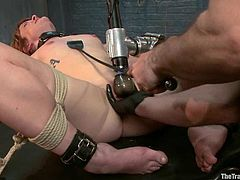 Kinky blonde girl gets tied up and then she rides a dildo. Later on the guy fixes clothespins to her nipples and toys her vagina.