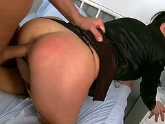She is brunette slutty doctor who seduces her patient and fucks him right in a hospital room. Nurses are spying on the action through the window.
