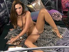 This breathtaking beauty wants to share her body. Watch this babe in high heels stripping for the camera and letting you see her shaved pussy.