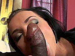 Hot horny brunette Anabell was sitting on the couch with sexy black fucker Kid Jamaica and got her mouth stuffed with his giant black dick